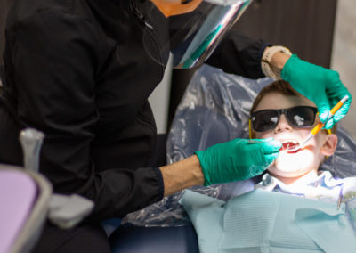Metro West Dental and Implant Institute | Hygienist & Young Patient